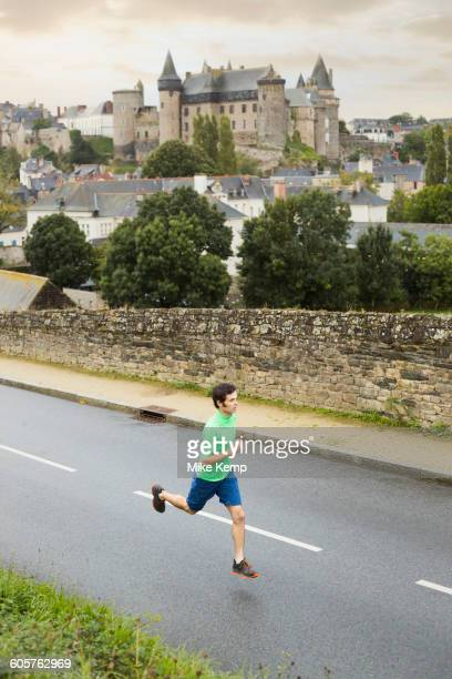 Caucasian man running outdoors