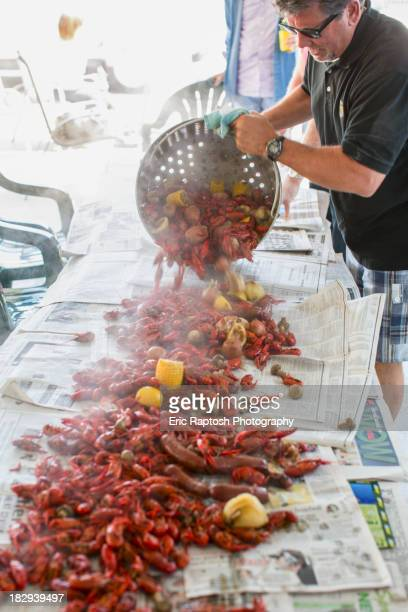 Caucasian man serving crawfish at boil