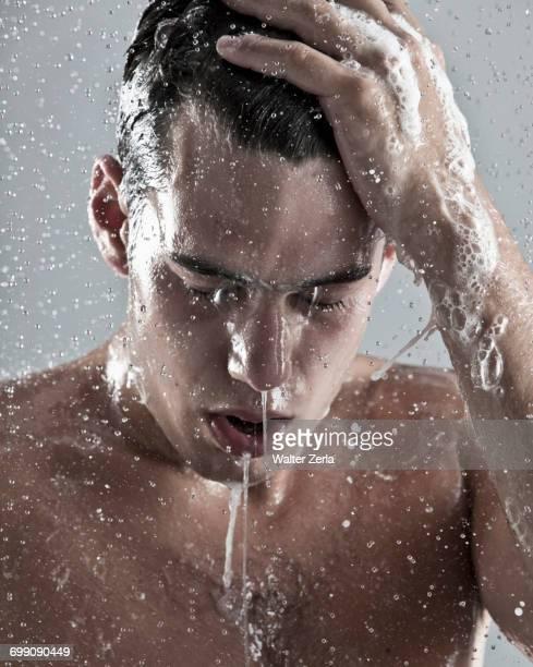 Caucasian man showering
