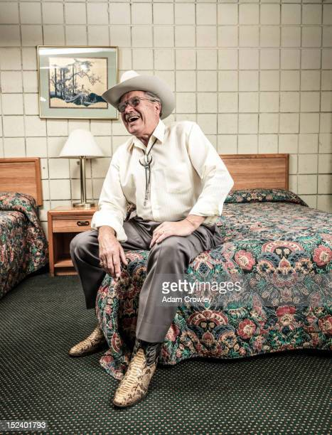 caucasian man sitting in hotel room - white boot stock pictures, royalty-free photos & images