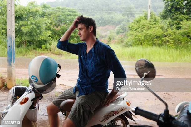 Caucasian man sitting on scooter