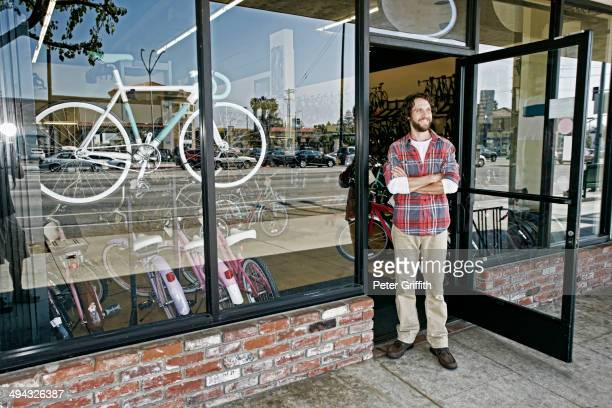 Caucasian man smiling in bicycle shop