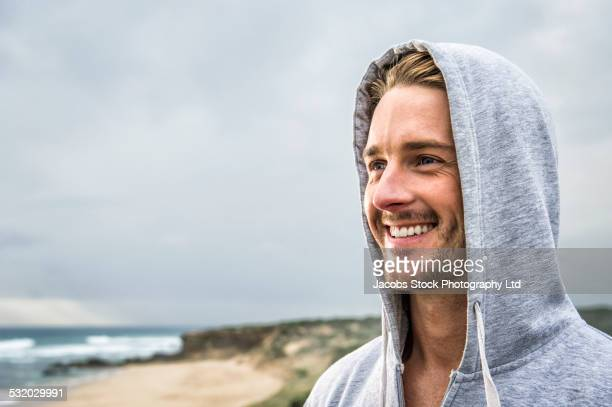 Caucasian man smiling on beach