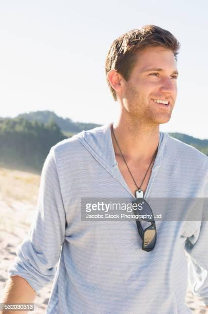Caucasian man smiling on beach