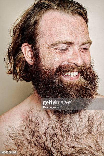 caucasian man smiling - hairy chest stock-fotos und bilder
