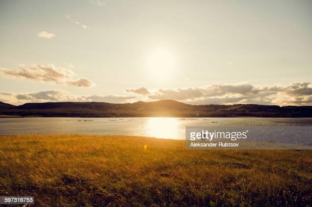 caucasian man standing at lake - semiarid stock-fotos und bilder
