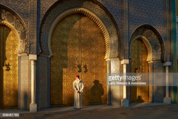 Caucasian man standing by ornate temple