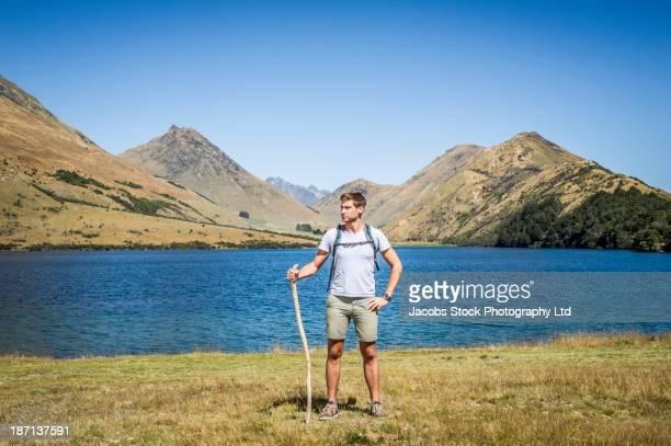 Caucasian man standing in rural landscape
