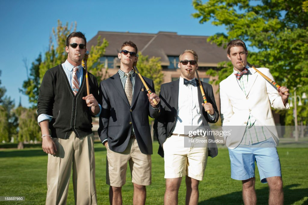 Caucasian man standing together with croquet mallets : Foto stock