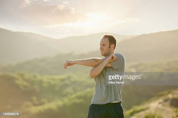 Caucasian man stretching before exercise