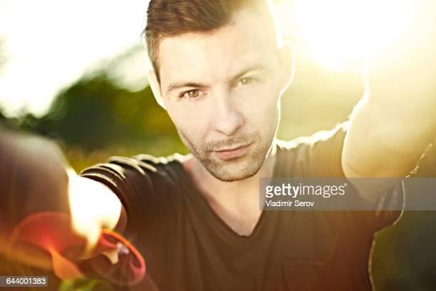 Caucasian man taking selfie outdoors