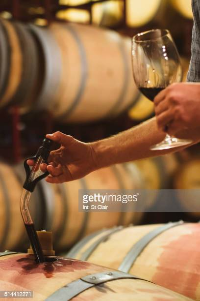 Caucasian man tasting wine