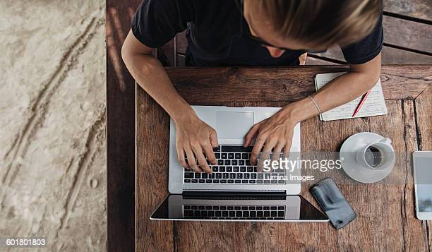 Caucasian man using laptop in cafe