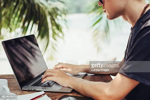 Caucasian man using laptop outdoors