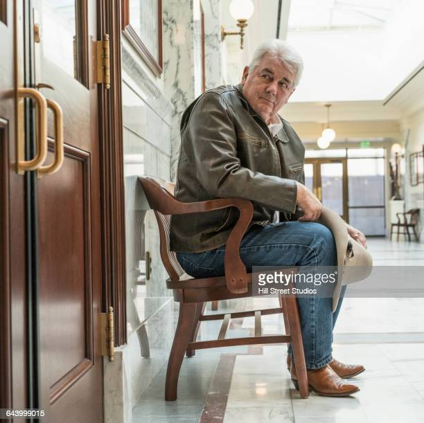 Caucasian man waiting in courthouse hallway