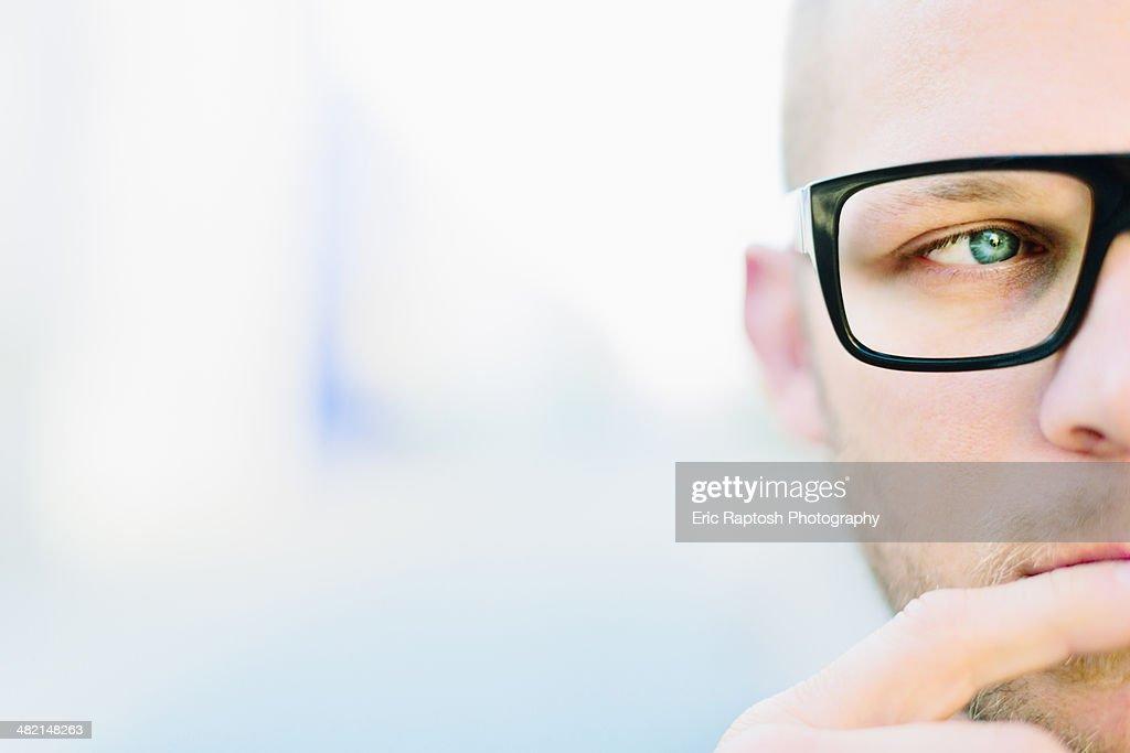 Caucasian man wearing eyeglasses : Stock Photo
