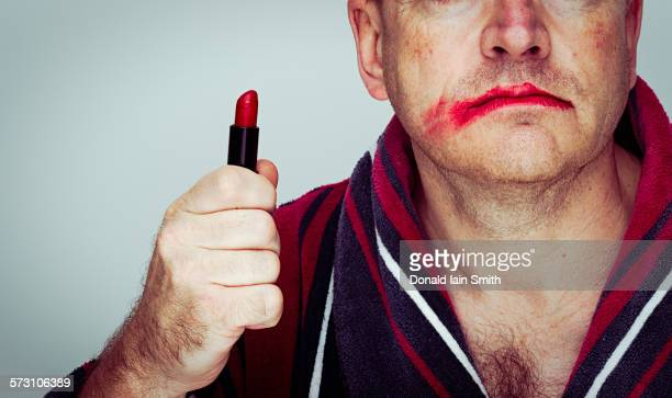 caucasian man wearing smeared lipstick - smudged stock pictures, royalty-free photos & images