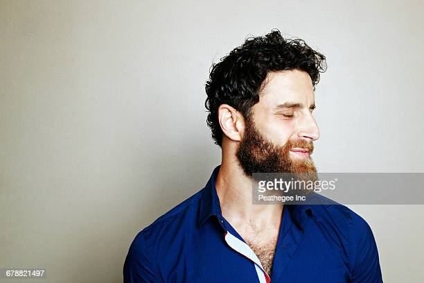 caucasian man with beard with eyes closed - augen geschlossen stock-fotos und bilder
