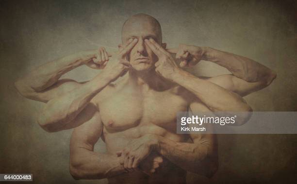 Caucasian man with multiple arms covering eyes and ears