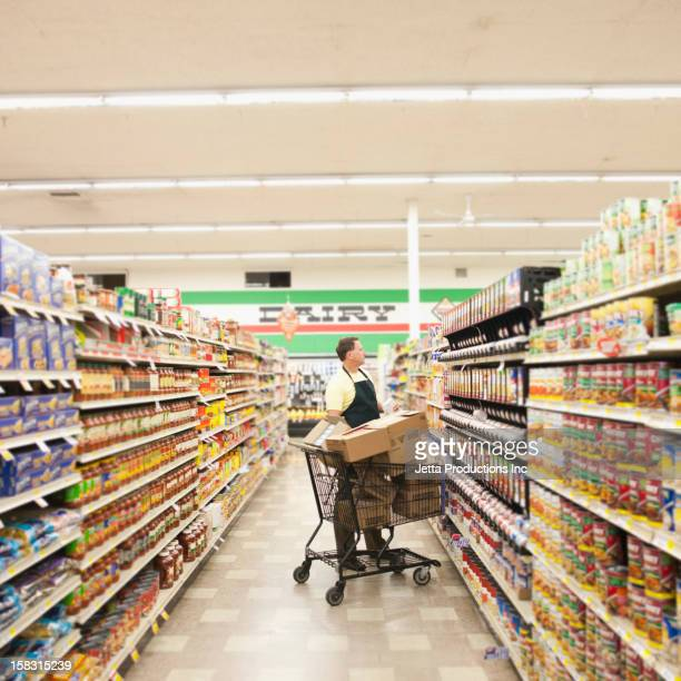 Caucasian man working in grocery store