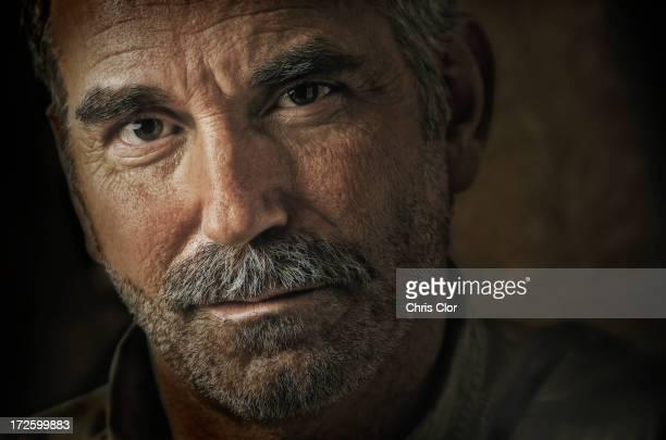 Caucasian man's grizzled face