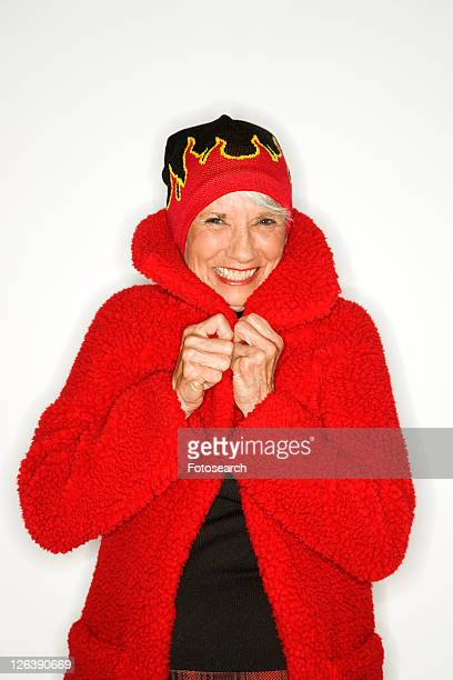 caucasian mature adult female in coat and flame hat. - hot women pics stock pictures, royalty-free photos & images