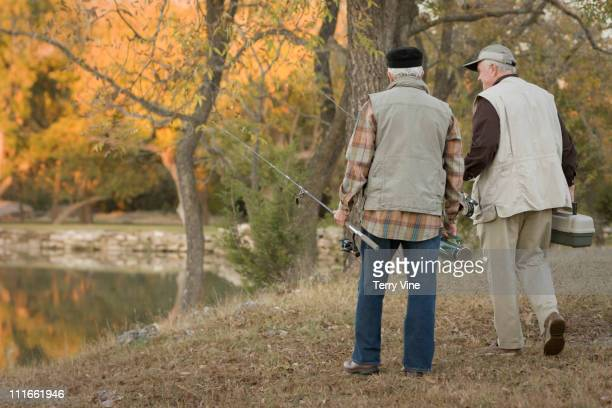 caucasian men fishing together - only senior men stock pictures, royalty-free photos & images