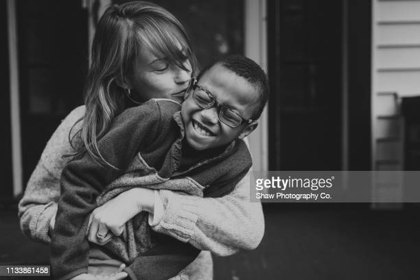 caucasian mother and adoptive african american son - black and white stock pictures, royalty-free photos & images