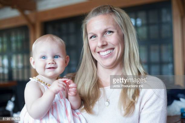 Caucasian mother and baby smiling