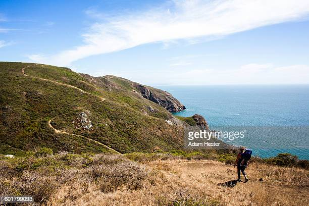 Caucasian mother and child hiking at coast