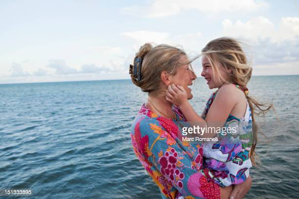 Caucasian mother and daughter enjoying the beach
