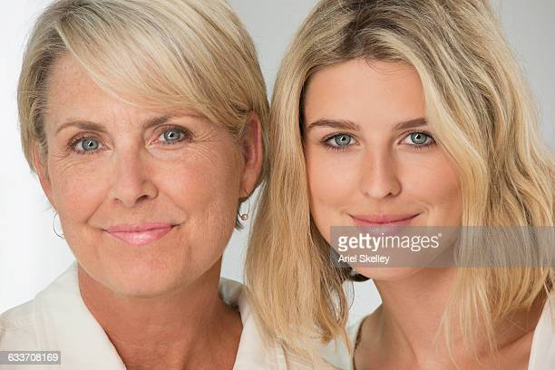 Caucasian mother and daughter smiling