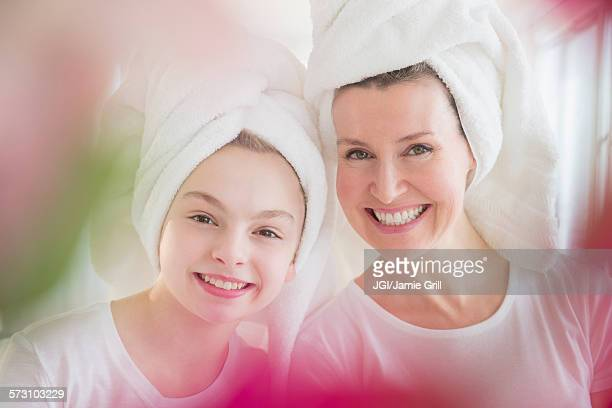 caucasian mother and daughter wearing towels in hair - mother daughter towel stock photos and pictures