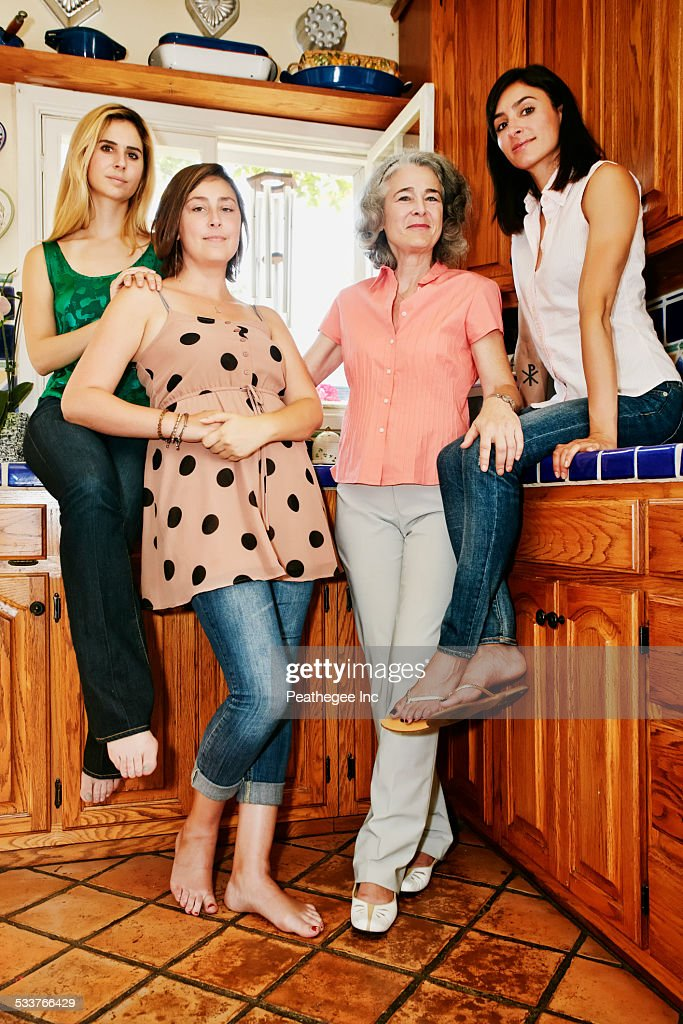 Caucasian mother and daughters smiling in kitchen : Foto stock