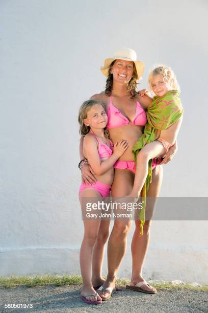 caucasian mother and daughters smiling on beach - thong bikini stock pictures, royalty-free photos & images