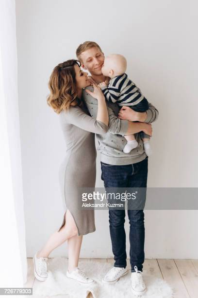 caucasian mother and father admiring baby son - two parents stock pictures, royalty-free photos & images