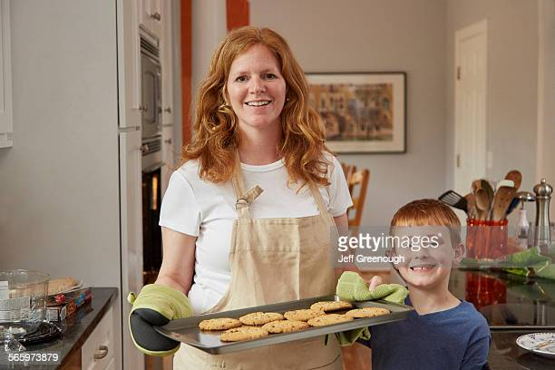 Caucasian mother and son baking cookies in kitchen