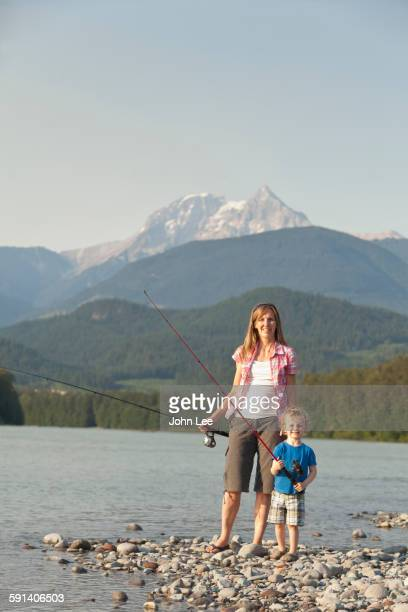 caucasian mother and son fishing in remote lake - ch 47 chinook stock photos and pictures
