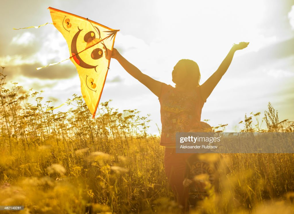 Caucasian mother and son flying kite in rural field : Stock Photo