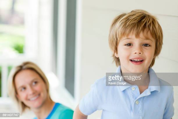 Caucasian mother and son on patio