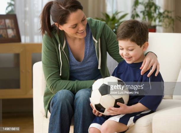 caucasian mother and son sitting with soccer ball - città di west new york new jersey foto e immagini stock