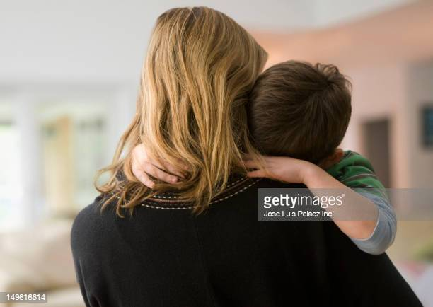 caucasian mother comforting son - sadness stock pictures, royalty-free photos & images
