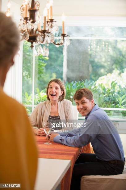 Caucasian mother surprising couple at table