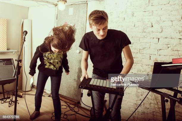 caucasian musicians playing in rock band - músico fotografías e imágenes de stock