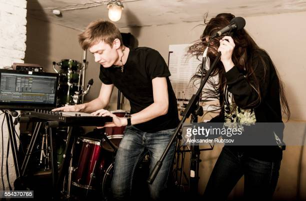 Caucasian musicians playing in rock band
