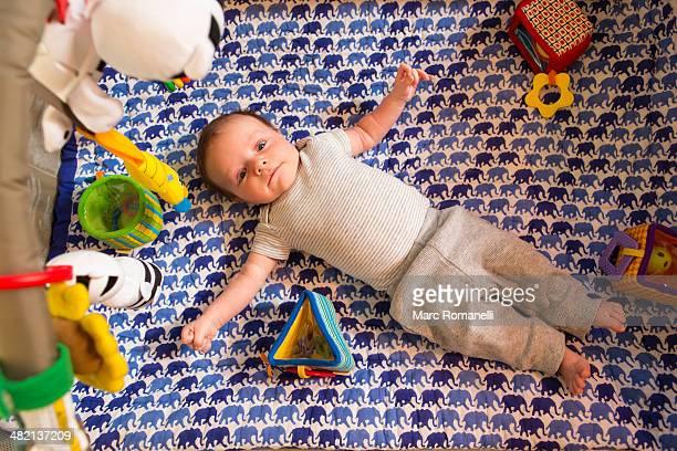 Caucasian newborn laying in crib