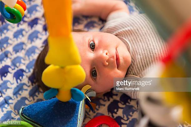 caucasian newborn laying in crib - baby mobile stock photos and pictures