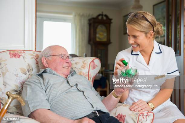 Caucasian nurse and patient eating in home