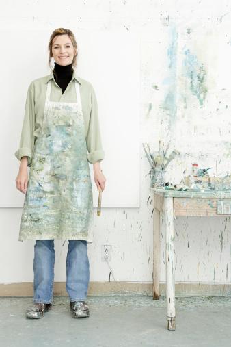 Caucasian painter smiling in studio - gettyimageskorea