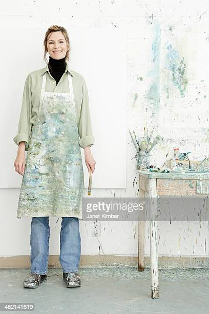 Caucasian painter smiling in studio